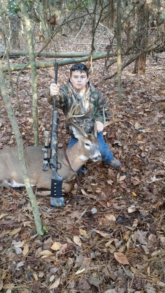 HERE'S MY BUDDY BRANDON WITH HIS FIRST BUCK. CLICK ON REPORTS FOR MORE PICS AND INFO ON HOLIDAY SPECIALS.